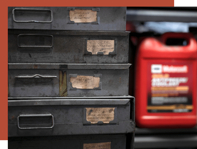 a canister of oil and a toolbox